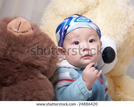 baby and his big teddy bears.