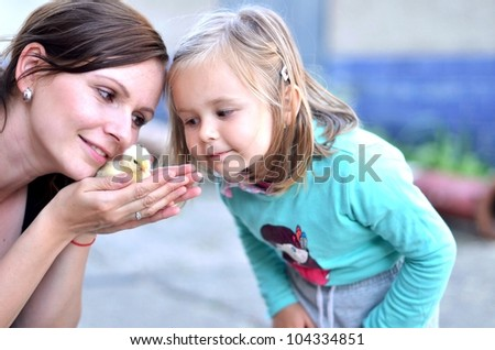 baby and mother with chicken
