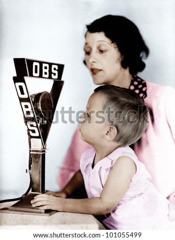 Baby and mother with radio microphone