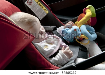 baby asleep in the car, in a safety seat
