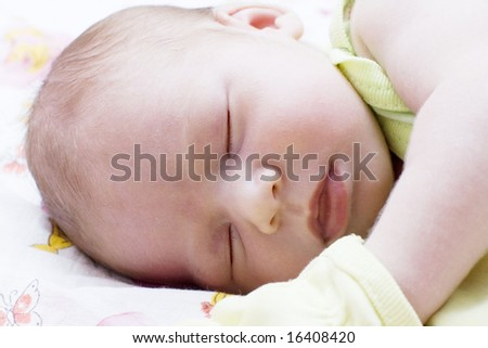 Baby asleep on the bed