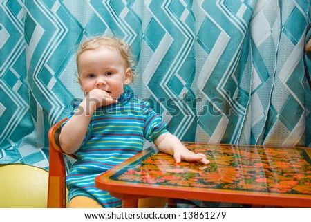 baby at table draw picture