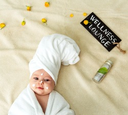Baby at wellness lounge. Spa.