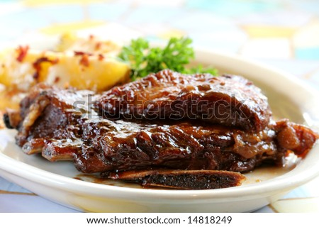 Baby Back Ribs and Baked Potatoes