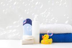baby bath products, baby care, Yellow rubber duck for bath games. Soap bubbles, bath foam, soap bubbles.