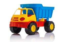 Baby beach toys. Plastic car or truck isolated on white background.