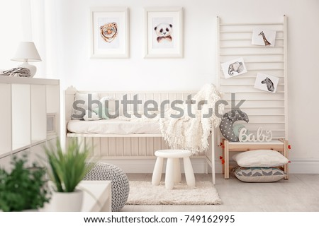 Baby bedroom decorated with pictures of animals #749162995