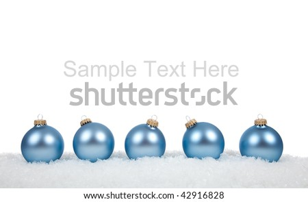 Baby blue Christmas ornaments/baubles on a white background with copy space