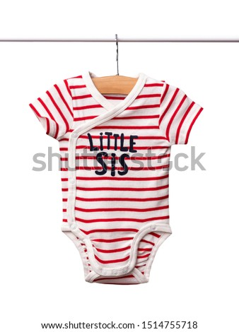Baby bodysuit hanging on a clothesline isolated on white background/ Close-up/ Baby clothes #1514755718
