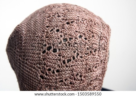 Baby bonnet taupe knit isolated on light background, baby accessory infant hat with detailed lace stitches of crafted yarn. #1503589550