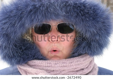 baby-boomer woman in furry hood and scarf