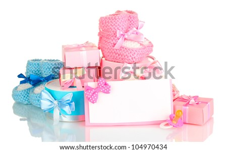 baby boots, pacifier, gifts and blank postcard  isolated on white