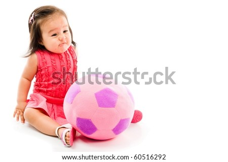 Baby bored with the plush doll on white background .