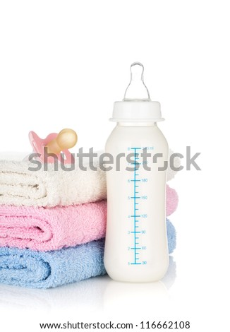 Baby bottle, pacifier and towels. Isolated on white background