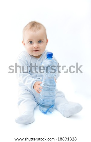 baby boy and bottle of mineral water, on white