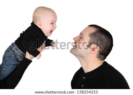 Baby boy and his dad against white background