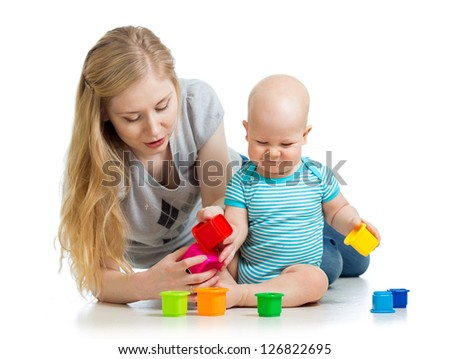 baby boy and mother playing together with colorful toys