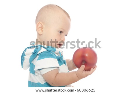 Baby boy, child eating a red apple on white background