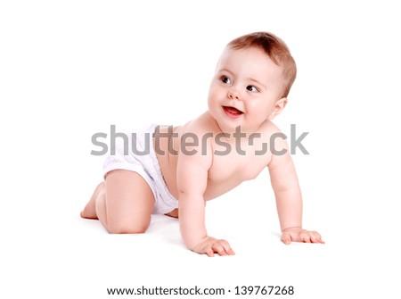 Baby boy crawling on white background