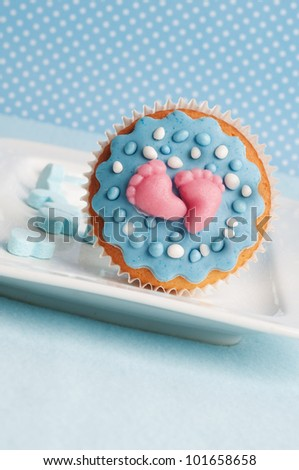 baby boy cupcake with feet and dots
