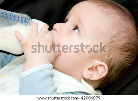 Baby-boy drinking milk from bottle