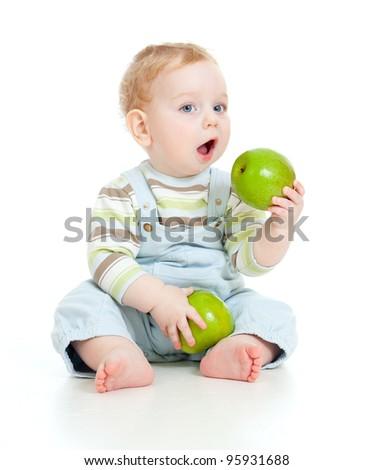 Baby boy eating healthy food isolated