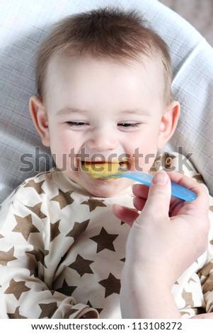 Baby boy eating vegetable mash