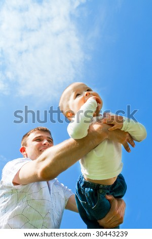 Baby boy flying on his father's hands