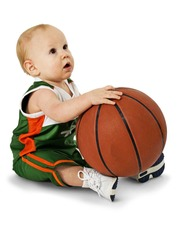 Baby boy holding basket ball. Clipping path.  Over white. Full body.