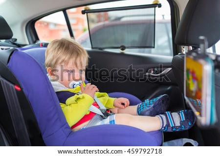 baby boy in a car on child...