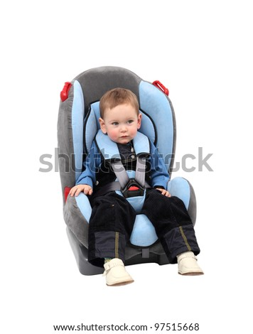 Baby boy in car seat. Isolated with clipping path.