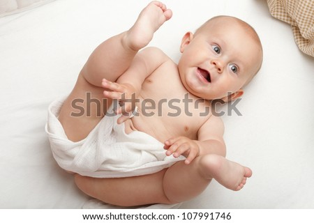 baby boy in diaper on white, blue eye