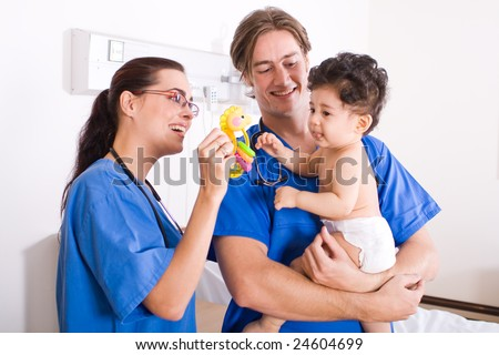 baby boy in hospital ward with doctor and nurse