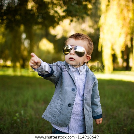 baby boy in the park in sun glasses