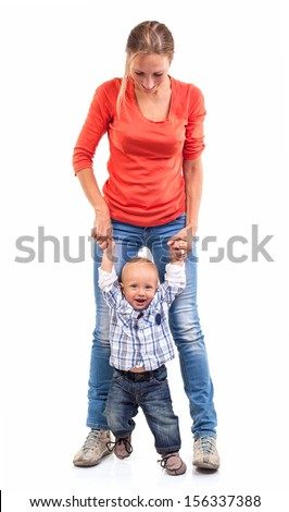 Baby boy learning to walk with mother's help over white