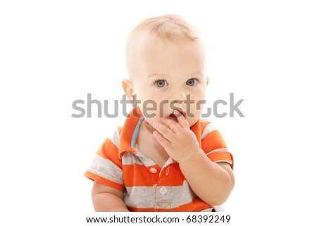 Baby boy looking shy, surprised or shocked, isolated on white
