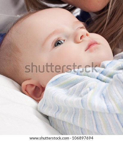 Baby boy lying on pillow
