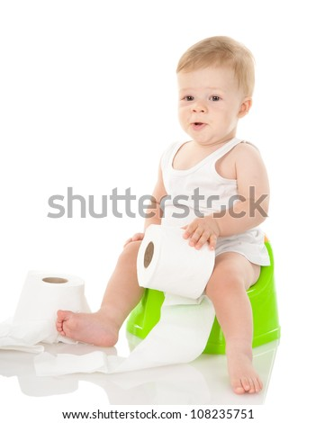 baby boy on chamber pot with toilet paper. isolated on white background