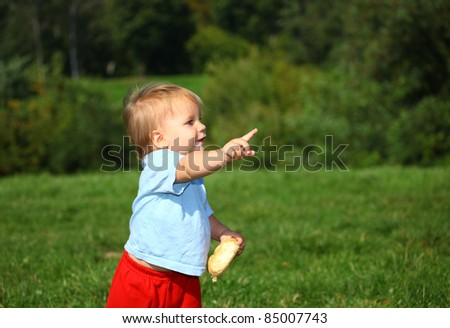 baby boy on the meadow in the sunny day, series