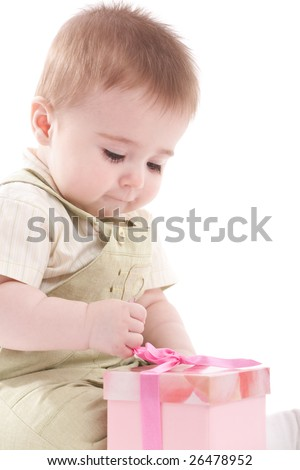 Baby boy open small pink gift box. Isolated on white