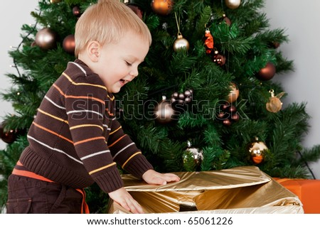 Baby boy opening a christmas-box
