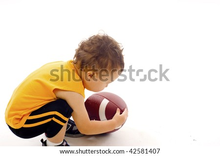 Baby Boy Pickup the  Football a lot of Copyspace - Isolated over a white background