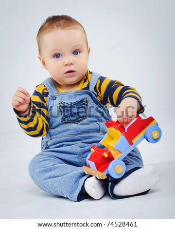 stock photo : baby boy plaing his toy car