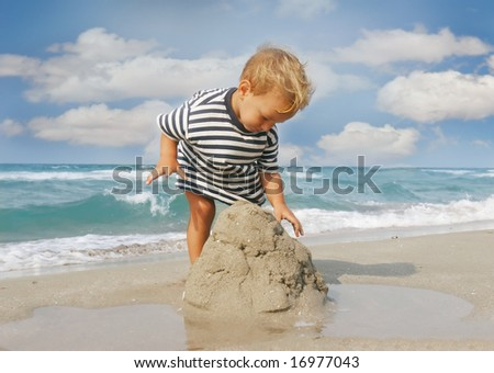 baby boy playing on beach