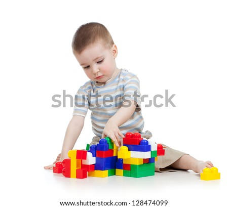 baby boy playing with block toy over white background