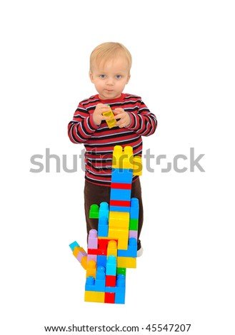 Baby boy playing with building blocks and smiling isolated on white