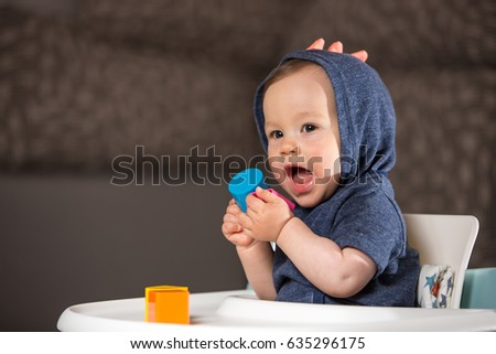 Baby boy playing with chewing toy. (9-month-old). #635296175