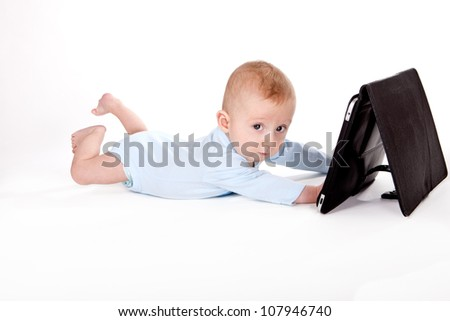 Baby boy playing with computer tablet