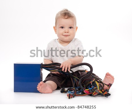baby boy playing with pc power supply on white background