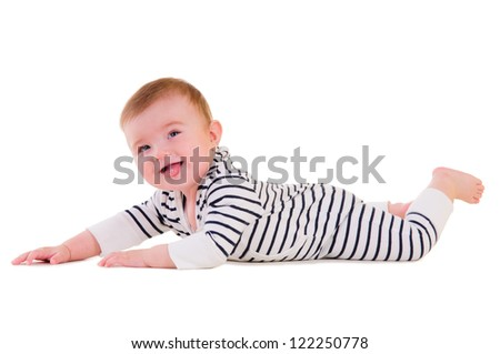 baby boy portrait isolated on white background. child  lying on his stomach on the floor and makes developing exercises